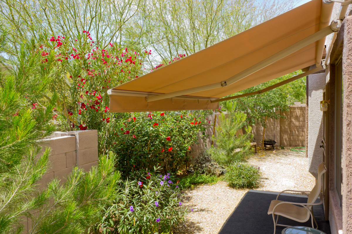 Folding arm awning for extra shade